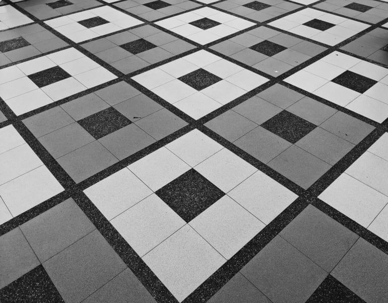 A black, grey and white square pattern tiled floor